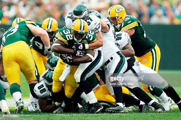 Green Bay Packers running back Brandon Jackson is stopped by Philadelphia Eagles linebacker Chris Gocong on a six yard run up the middle in the first...