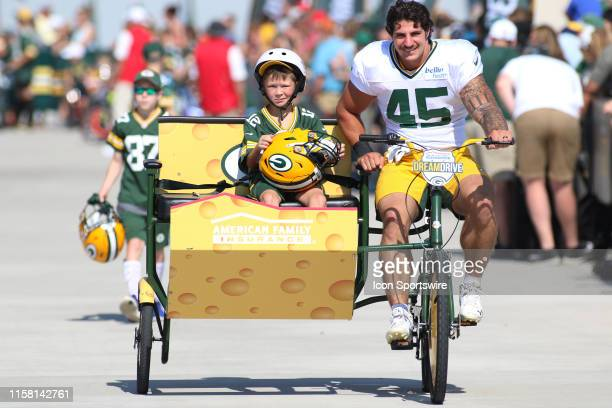 Green Bay Packers running back Danny Vitale rides a specially made bike for American Family Insurance during Green Bay Packers Training Camp at Ray...