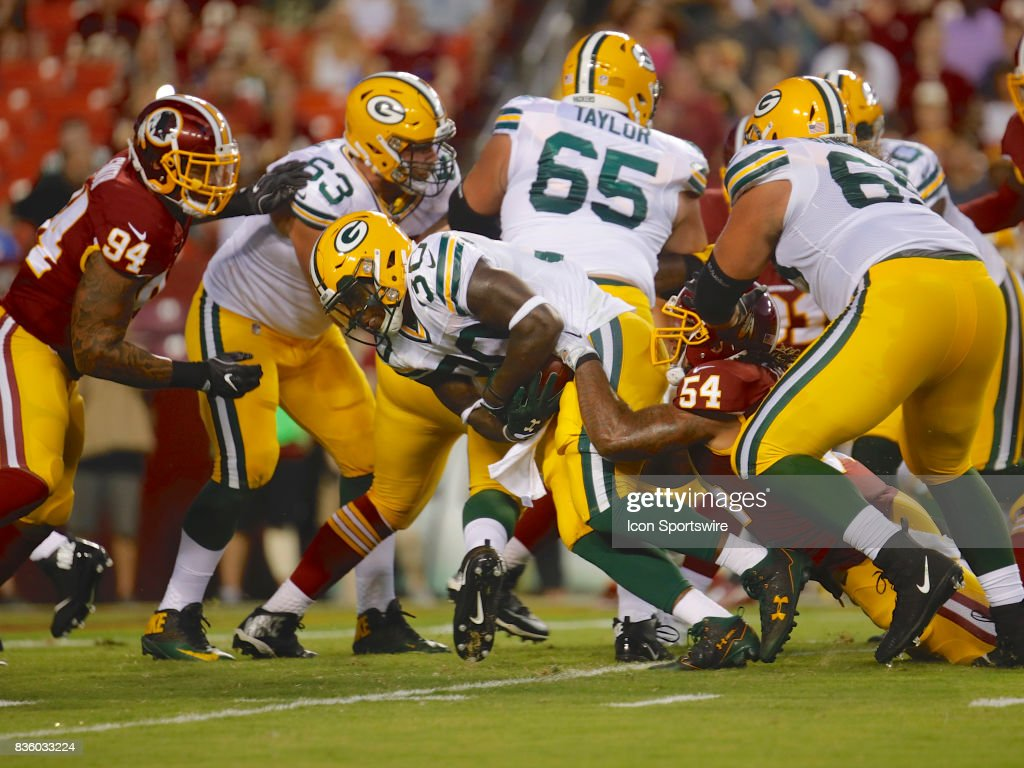 Green Bay Packers Running Back Jamaal Williams (30) advances the ball during the NFL preseason game between the Green Bay Packers and the Washington Redskins at FedEx Field on August 19 2017, in Landover, MD.