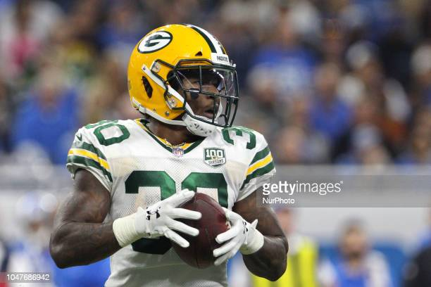 Green Bay Packers running back Jamaal Williams holds the ball after a play during the second half of an NFL football game against the Green Bay...
