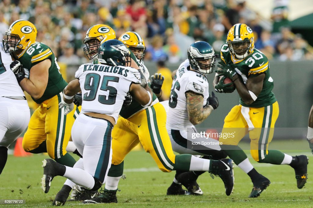 Green Bay Packers running back Jamaal Williams (30) looks for a hole during a football game between the Green Bay Packers and the Philadelphia Eagles on August 10, 2017, at Lambeau Field in Green Bay, WI.