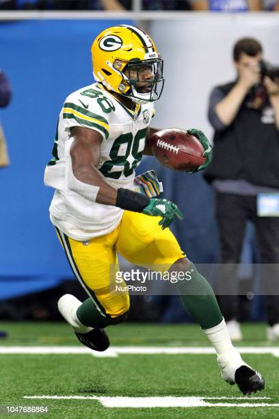 Green Bay Packers running back Ty Montgomery runs the ball during the first half of an NFL football game against the Detroit Lions in Detroit...