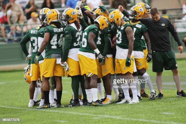 Green Bay Packers safeties and corner backs huddle during Green Bay Packers Organized Team Activities at Ray Nitschke Field on May 31 2018 in Green...