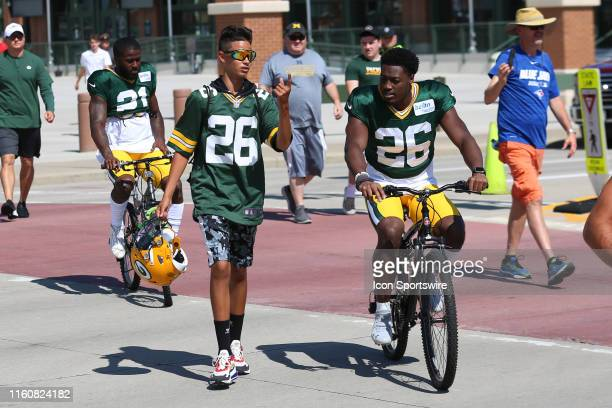 Green Bay Packers safety Darnell Savage rides with a fan during practice at Green Bay Packers Training Camp at Ray Nitschke Field on August 10 2019...
