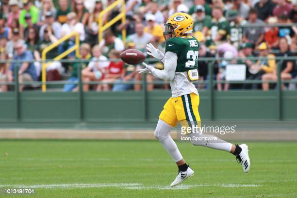 Green Bay Packers safety Josh Jones makes a catch during Green Bay Packers training camp at Ray Nitschke Field on August 7 2018 in Ashwaubenon WI