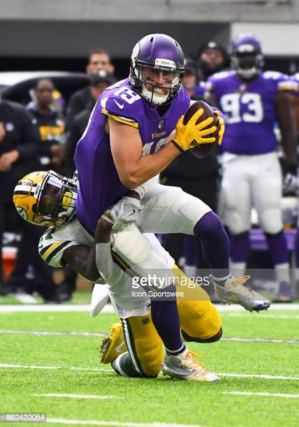 Green Bay Packers safety Josh Jones wraps up Minnesota Vikings wide receiver Adam Thielen during a NFL game between the Minnesota Vikings and Green...