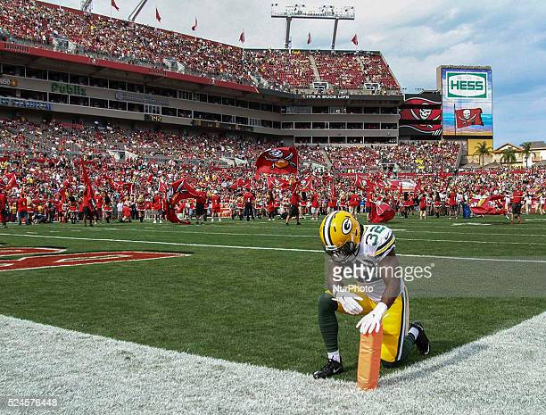 Green Bay Packers strong safety Chris Banjo kneels in the end zone before the Green BayTampa Bay football game December 21 2014 at Raymond James...