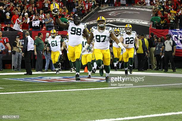 Green Bay Packers take the field before the NFC Championship Game game between the Green Bay Packers and the Atlanta Falcons on January 22 at the...