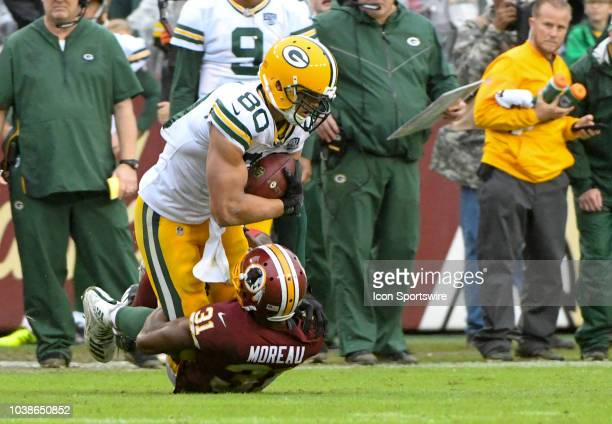 Green Bay Packers tight end Jimmy Graham makes a pass reception and is brought down by Washington Redskins cornerback Fabian Moreau on September 23...