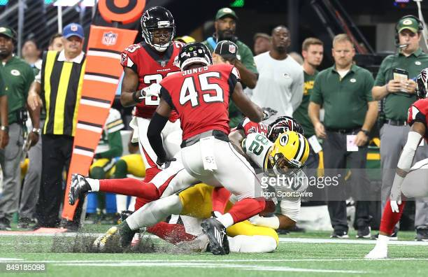 Green Bay Packers tight end Richard Rodgers gets tackled by Atlanta Falcons strong safety Keanu Neal during the NFL game between the Green Bay...