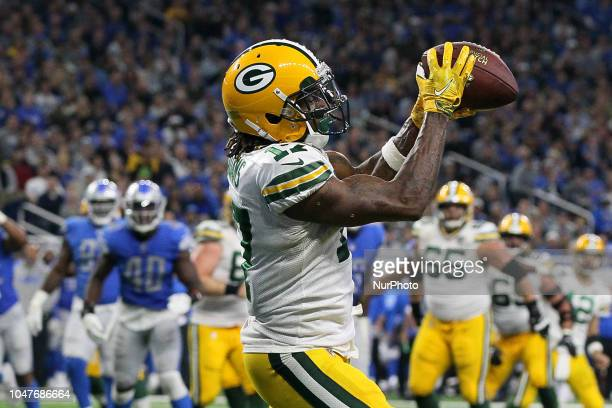 Green Bay Packers wide receiver Davante Adams catches a pass for a touchdown during the second half of an NFL football game against the Detroit Lions...