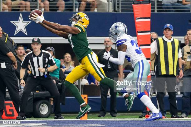 Green Bay Packers wide receiver Davante Adams stretches to make a touchdown reception during the football game between the Green Bay Packers and...