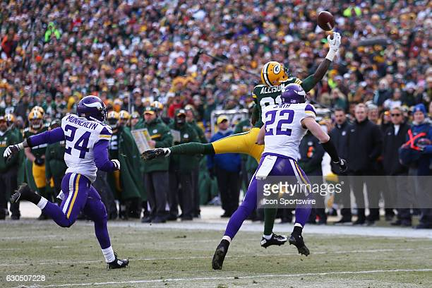 Green Bay Packers Wide Receiver Geronimo Allison reaches for an errant pass during the game between the Green Bay Packers and Minnesota Vikings on...
