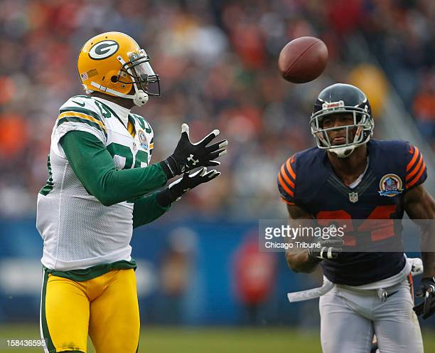 Green Bay Packers wide receiver James Jones catches a touchdown in front of Chicago Bears cornerback Kelvin Hayden in the second quarter at Soldier...