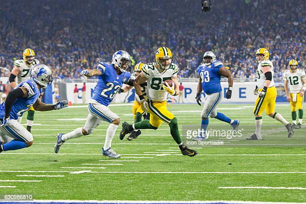 Green Bay Packers wide receiver Jordy Nelson runs with the ball after catching a pass while Detroit Lions corner back Darius Slay ties to make the...