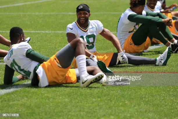 Green Bay Packers wide receiver Randall Cobb laughs while stretching during Green Bay Packers Organized Team Activities at Ray Nitschke Field on June...