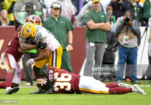 Green Bay Packers wide receiver Randall Cobb makes a reception and is stripped of the ball by Washington Redskins defensive back Josh Norman as...