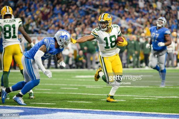 Green Bay Packers wide receiver Randall Cobb stiff arms his way into the end zone during a NFL football game between Detroit and Green Bay on...