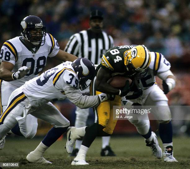 Green Bay Packers wide receiver Sterling Sharpe catches a pass between a pair of defenders during a 2117 loss to the Minnesota Vikings on December 19...
