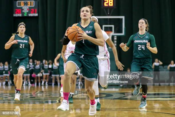 Green Bay Phoenix guard Jen Wellnitz drives to the basket on a fast break during the second quarter of the women's college basketball game between...