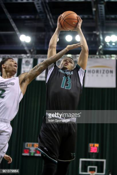 Green Bay Phoenix guard Trevian Bell grabs a rebound against Cleveland State Vikings Anthony Wright during the second half of the men's college...