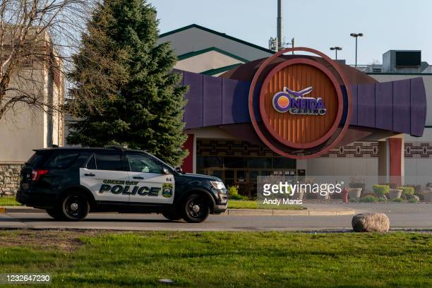Green Bay Police officer drives by the casino on May 2, 2021 in Green Bay, Wisconsin. A gunman killed two people and seriously wounded a third before...