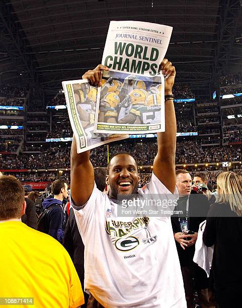 Green Bay practice squad wide receiver Chastin West holds a newspaper at the end of Super Bowl XLV where the Green Bay Packers beat the Pittsburgh...