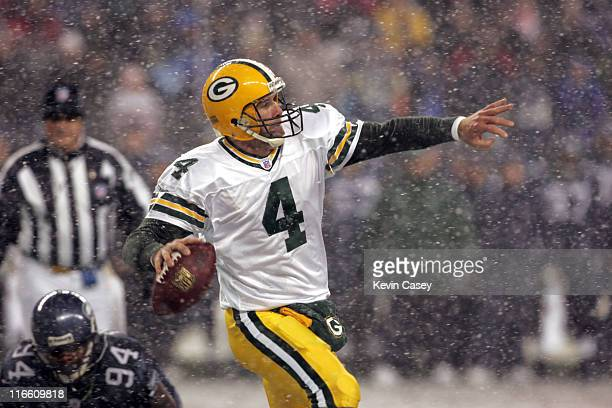 Green Bay quarterback Brett Favre throws downfield as he runs out of the backfield away from Seahawks Bryce Fisher during the first half of the NFL...