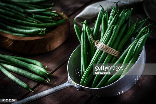 Green beans in an old metal colander