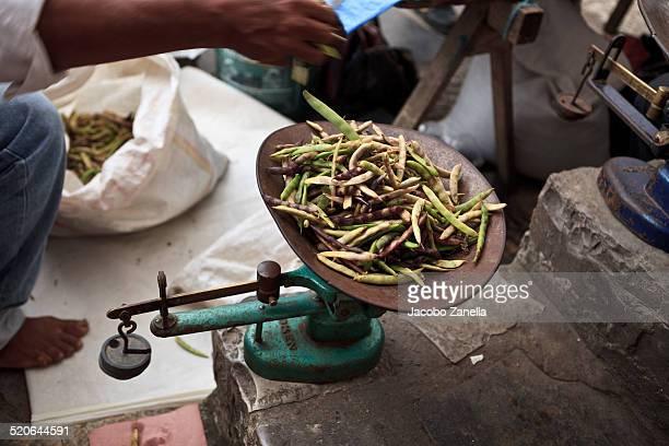 green beans on an old scale - bush bean stock photos and pictures