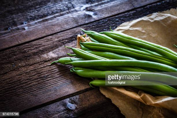 Green beans on rustic wooden table