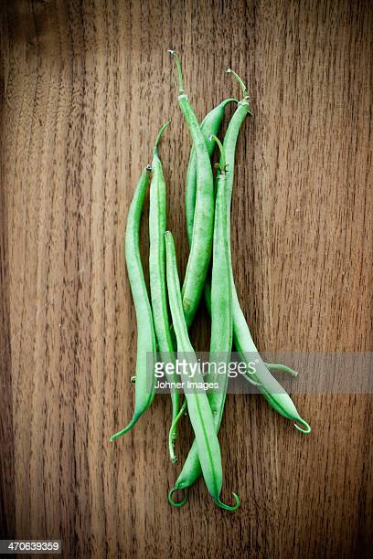 Green beans on wooden table