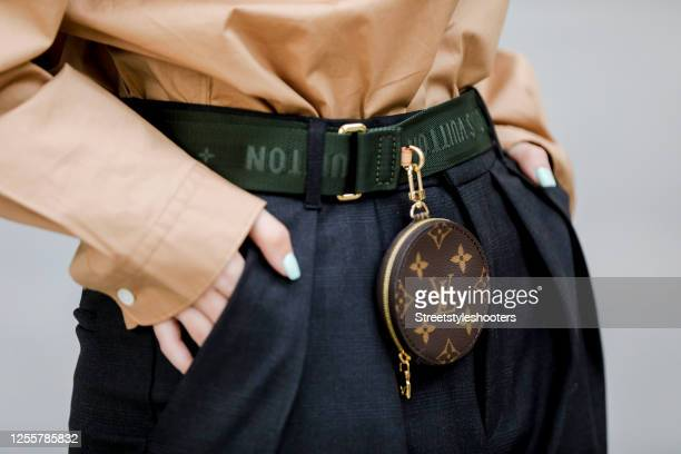 Green belt with round monogram pouch by Louis Vuitton as a detail of influencer Maria Barteczko during a street style shooting on July 12, 2020 in...
