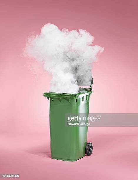green bin - burning stock pictures, royalty-free photos & images