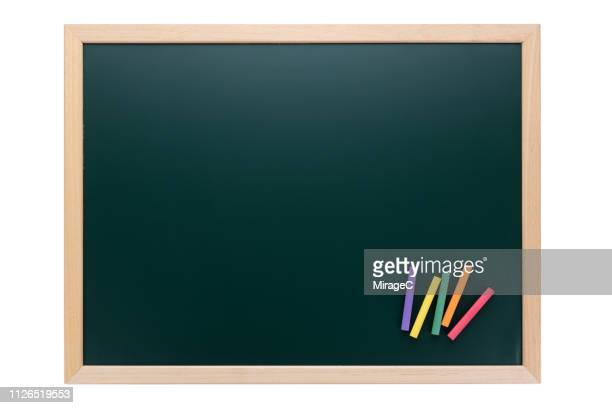 green blackboard with color chalks on white - quadro negro imagens e fotografias de stock