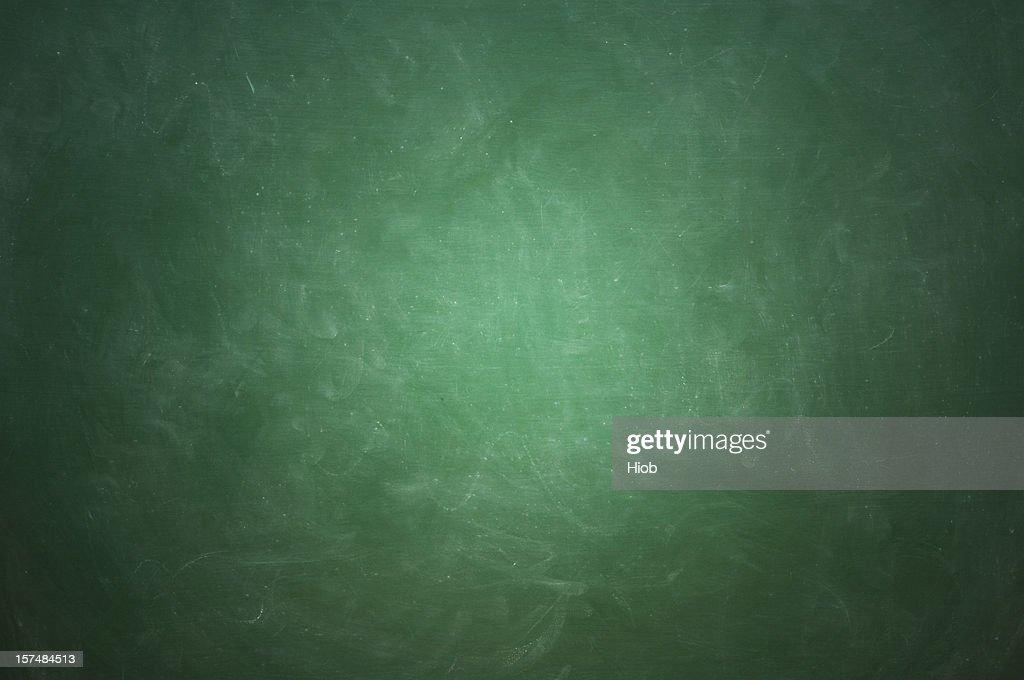 Green blackboard with white chalk streaks : Stock Photo