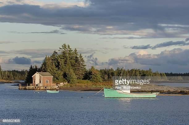 Green boat Blue Rocks Nova Scotia