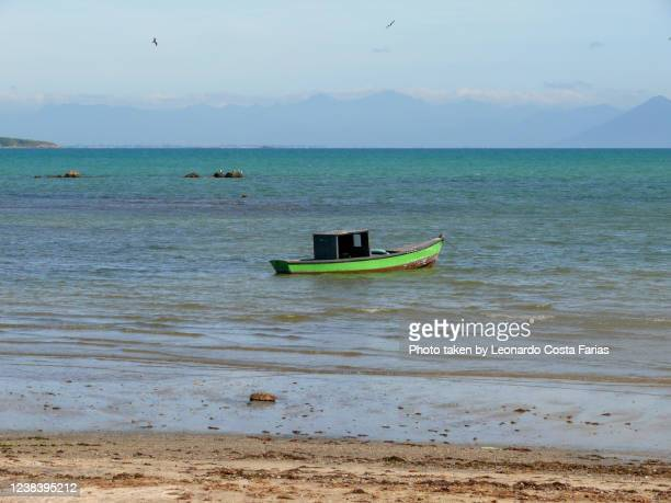 green boat - leonardo costa farias stock pictures, royalty-free photos & images
