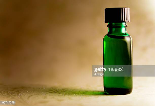 Green bottle of essential oil
