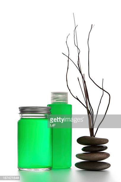 Green  bottles. pebbles and dry branches
