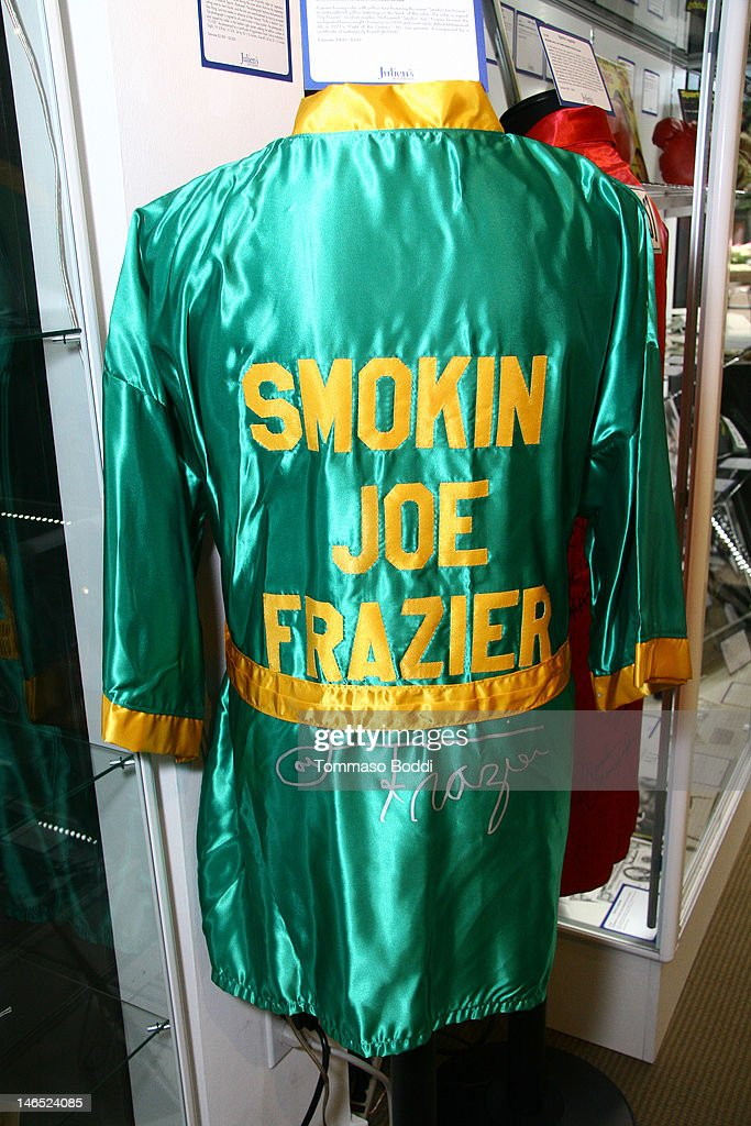 A green boxing robe signed by Joe Frazier is displayed at the Julien's Auctions press call for Music Icons And Sports Legends Memorabilia Auction held at Julien's Auctions Gallery on June 18, 2012 in Beverly Hills, California.