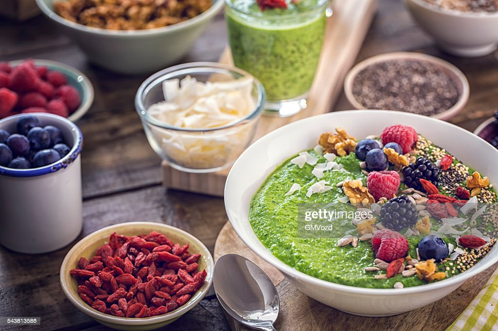 Green Breakfast Smoothie in Bowl with Superfoods on Top : Stock Photo