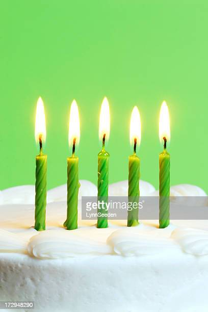 Green candles on a cake