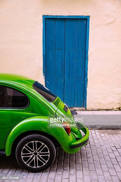 Green car and blue door