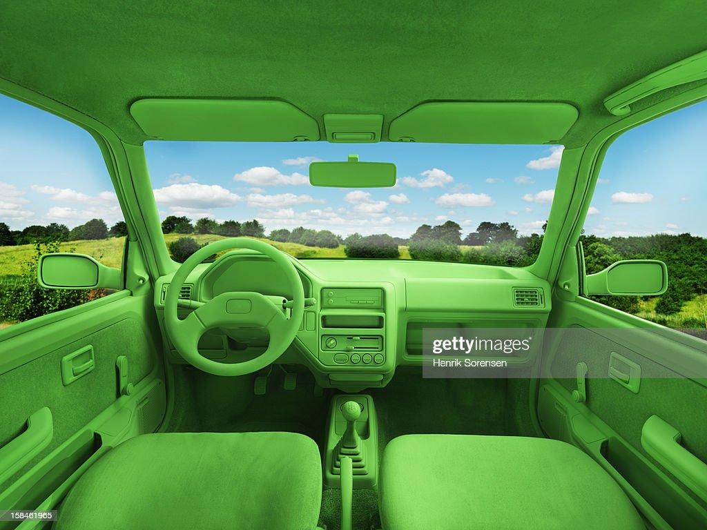 Green car, environment. (In landscape) : Bildbanksbilder