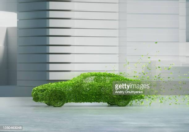 green car in city - hybrid car stock pictures, royalty-free photos & images