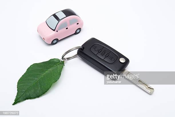 green car key and vehicle on white - alternative fuel vehicle stock pictures, royalty-free photos & images