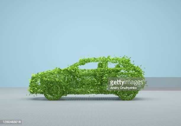 green car - environmental damage stock pictures, royalty-free photos & images