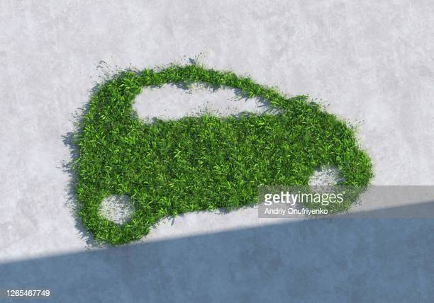 green car - alternative fuel vehicle stock pictures, royalty-free photos & images