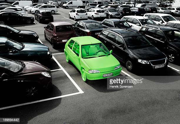 green car, sustainable energy. (parking lot) - alternative fuel vehicle stock pictures, royalty-free photos & images